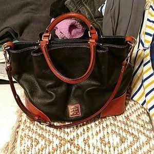 Hand bag with shoulder strap.